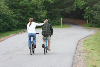 Image of romantic couple on bikes