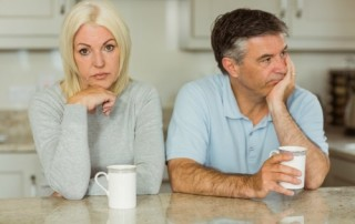Young couple having relationship difficulties, shallow depth of field focus on foreground